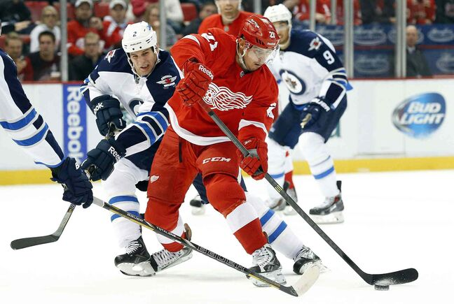 Winnipeg Jets defenceman Adam Pardy (2) defends against Detroit Red Wings forward Tomas Tatar during the second period.