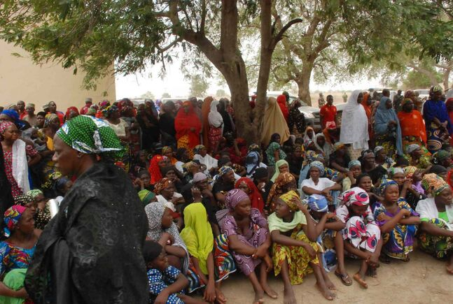 Mothers and some of the kidnapped school girls from the government secondary school Chibok, who managed to escape, gather under a tree prior to the visit of Nana Shettima, the wife of Borno Governor, Kashim Shettima, in Chibok, Nigeria. The plight of the 276 kidnapped girls - and the failure of the Nigerian military to find them - has drawn international attention to an escalating Islamic extremist insurrection that has killed more than 1,500 so far this year