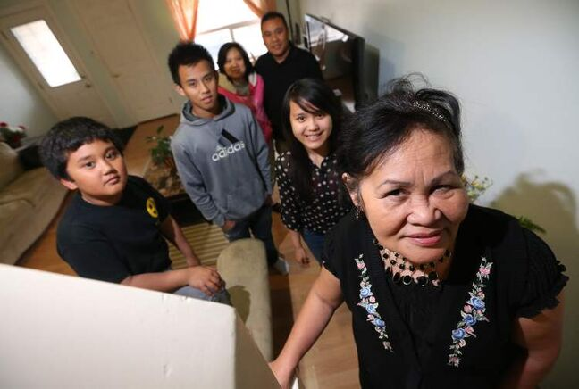 '(The new immigration rules) have a huge impact on the welfare and the future of the next generation' -- Gloria Agravante, an immigrant from the Philippines, posing with her grandchildren,  Kristine, 16, Jared, 9 and Gympson 16 -- her son and daughter-in-law, Genesis and Juliet.