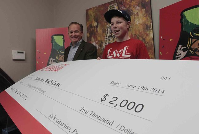 Nathan Unrau, Founder of Lunches with Love, a Winnipeg-based non-profit organization that makes paper bag lunches in support of Winnipeg homeless shelters was presented with a $2,000 cheque from Coca-Cola Thursday morning by John Guarino, President, Coca-Cola Refreshments Canada.