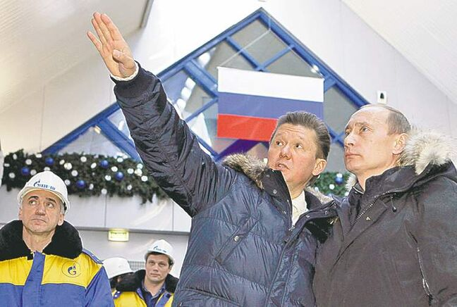 Russian President Vladimir Putin (right) listens as Gazprom CEO Alexei Miller describes the newly opened alpine ski centre, built by Gazprom,  in Sochi.