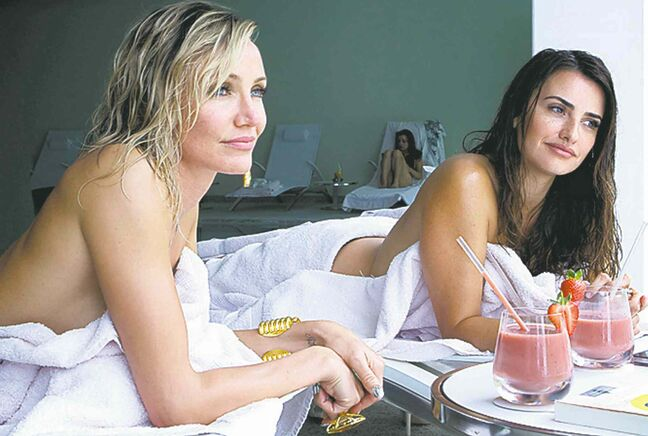 Cameron Diaz, left, as Malkina, uses Penalope Cruz, as Laura, to glean some invaluable information that may have dire consequences, in The Counselor.