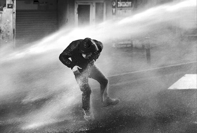 Riot police use water cannons and teargas to disperse people who were protesting the Soma mine disaster that killed 301 miners, in Istanbul, Turkey, Thursday, March 22, 2014. A protester was seriously injured during clashes.