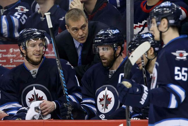 Winnipeg Jets' head coach Paul Maurice has a second-period chat with Bryan Little (18) and Andrew Ladd (16) on the bench as the team plays the Toronto Maple Leafs in Winnipeg Saturday.