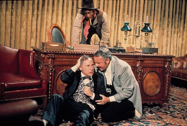 Cleavon Little (top), Mel Brooks (left) and Harvey Korman in a scene from Blazing Saddles, which is 40 years old.