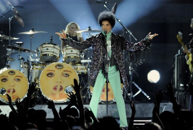 In this May 19, 2013 file photo, Prince performs at the Billboard Music Awards at the MGM Grand Garden Arena, in Las Vegas. Fox's post-Super Bowl party will include Prince making a guest appearance on the comedy