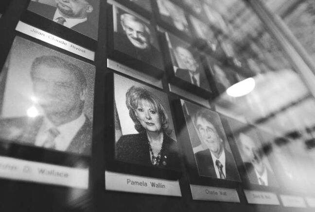 A photograph of beleaguered Sen. Pamela Wallin is displayed alongside photographs of her fellow senators in the Centre Block of Parliament Hill in Ottawa on Tuesday.