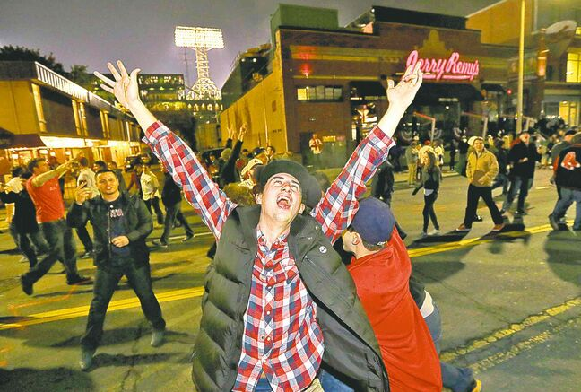 Red Sox fans celebrate in the street near Fenway Park following Game 6.