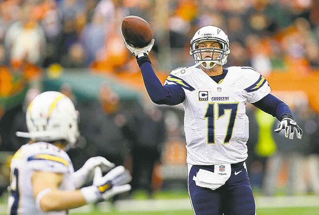 Chargers QB Philip Rivers tosses a pass to running back Danny Woodhead.