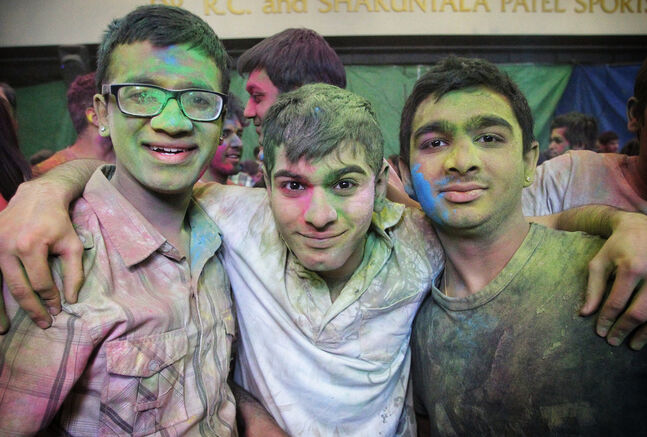 (L-r) Harsh Patel, Sagar Patel and Vismay Patel gathered to observe Holi, a religious spring festival celebrated by Hindus as a festival of colours at the Dr. Raj Pandey Hindu Centre Sunday afternoon.