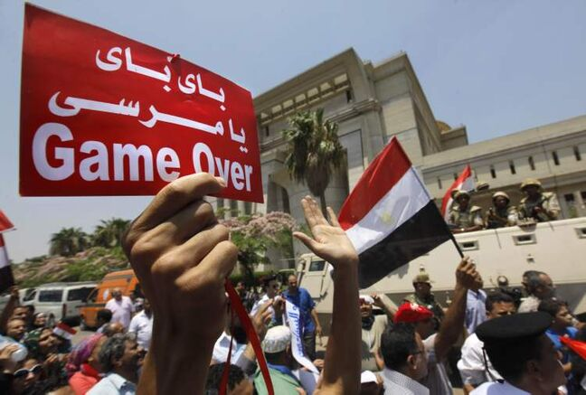 Egyptians celebrate in front of the constitutional court in Cairo on July 4.