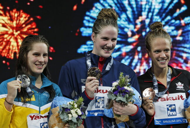 From left: Australia's Belinda Hocking, silver, Missy Franklin of the United States. gold, and Canada's Hilary Caldwell, bronze, smile as they hold their medals during the presentation ceremony for the Women's 200m backstroke final at the FINA Swimming World Championships in Barcelona, Spain, Saturday.