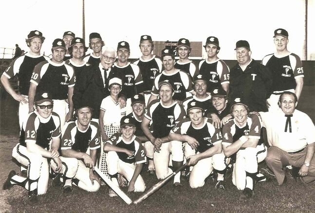 The Winnipeg Colonels of the Western Major Fastball League pose with their namesake, Kentucky Fried Chicken founder Col. Harland Sanders. The Colonels won the WMFL championship in 1973.