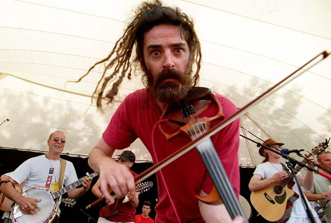 Angus Grant of Shooglenifty from Scotland jams with groups Tabache and Wild Mountain Time on a Sunday afternoon at the Winnipeg Folk Festival at Birds Hill Park. July 09, 2000. (JOE BRYKSA / WINNIPEG FREE PRESS)