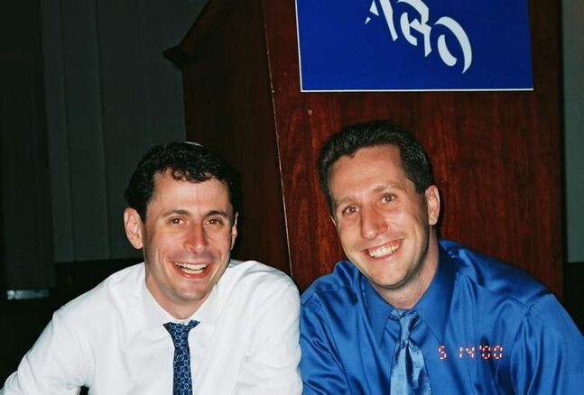 Adam Anhang, left, was beaten and stabbed to death in the Puerto Rican capital of San Juan in 2005.