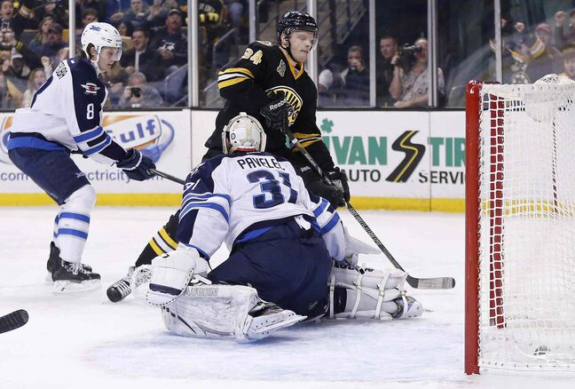 Boston Bruins' Carl Soderberg (34) scores past Winnipeg Jets' Ondrej Pavelec (31) during the game's second period in Boston Saturday.