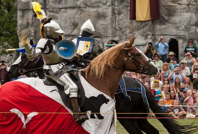 Alison Mercer (left) is knocked hard during a pass in a jousting competition by Jordan Heron. Mercer travelled from Calgary and Heron from Niagara-on-the-Lake, Ontario to joust at the 2012 Medieval Festival at the Immaculate Conception Church and Grotto on Saturday in Cooks Creek.