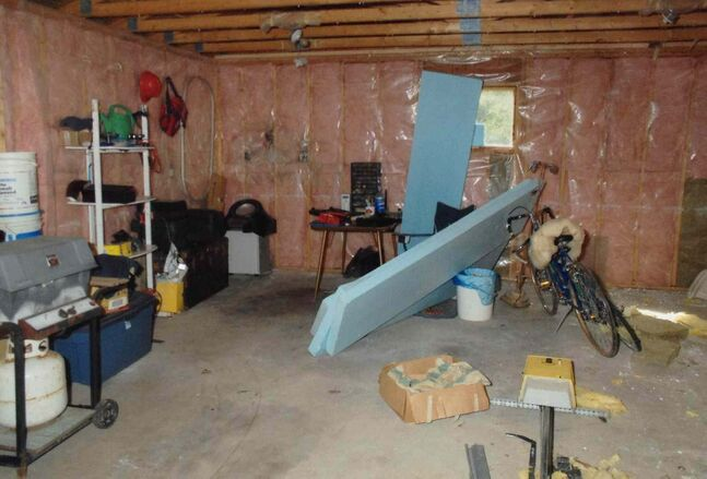 A court exhibit photo shows the garage where investigators found a drop of murder victim Chad Davis's blood.