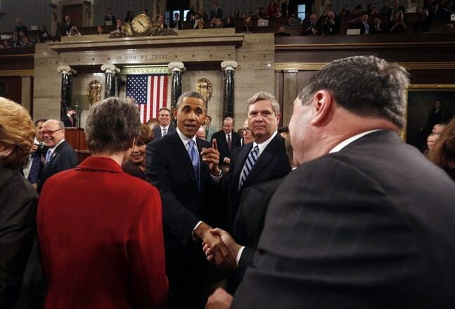 President Barack Obama shakes hands as he leaves after giving the State of Union address before a joint session of Congress in the House chamber Tuesday, Jan. 28, 2014, in Washington. (AP Photo/Larry Downing, Pool)