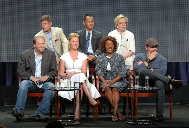 This image released by NBC shows, back row from left, executive producers Bob Simonds, Rodney Faraon, Nancy Heigl, and front row from left, executive producers Ed Bernero, Katherine Heigl, actress Alfre Woodard and executive producer Joe Carnahan at the
