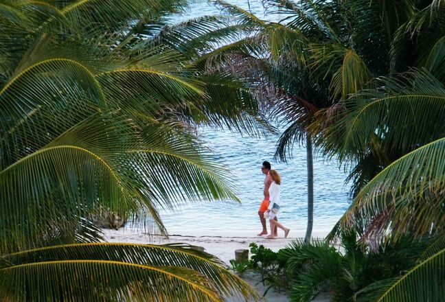 Something to Belize in: A couple enjoys the beach at the Blue Dolphin resort.