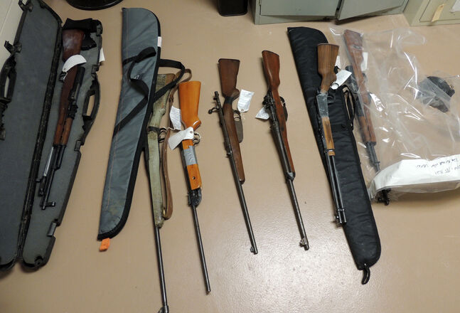 RCMP seized prohibited and stolen firearms and ammunition from two homes on Sandy Bay First Nation.