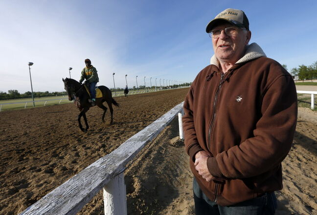 Trainer Murray Duncan and groom John Mills give Go Go Lolo a light workout at Assiniboia Downs Thursday.