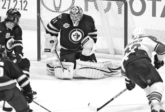 John Woods / the canadian pressOndrej Pavelec stops Florida�s Sean Bergenheim on this shot during third-period action Thursday. Pavelec made 33 saves for his fourth shutout of the season.