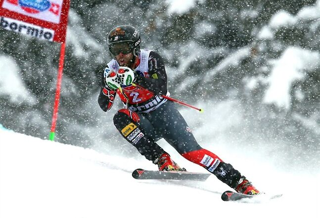Travis Ganong, of the United States, speeds down the course during an alpine ski, men's World Cup downhill, in Bormio, Italy, Sunday, Dec. 29, 2013. (AP Photo/Alessandro Trovati)