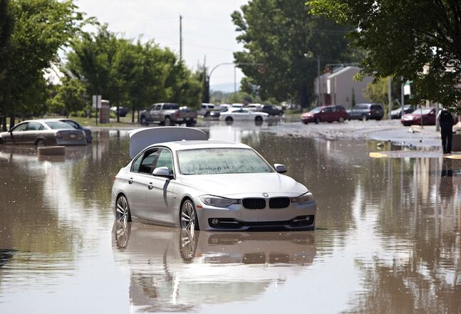 Water slowly recedes from the deserted streets of High River, Alta. on Saturday after the Highwood River overflowed its banks.
