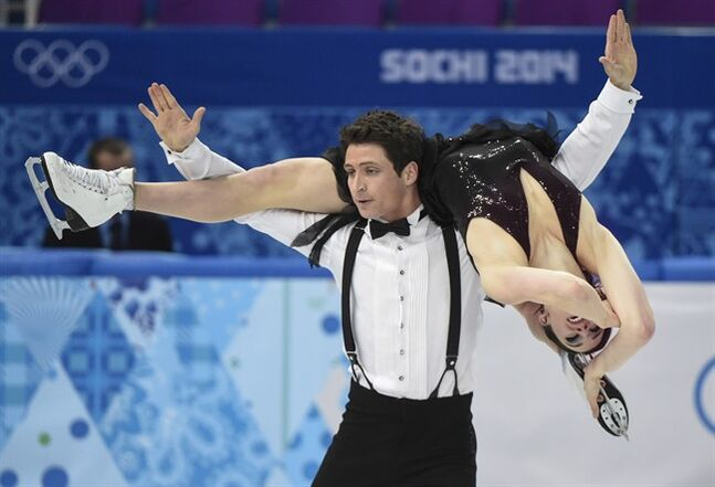 Canada's Tessa Virtue and Scott Moir perform their short dance in the ice dance portion of the team figure skating event at the Sochi Winter Olympics Saturday, February 8, 2014 in Sochi. THE CANADIAN PRESS/Paul Chiasson