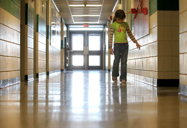 Latisha Smith, 7, walks down an empty hallway in Reynolds Community School in Prawda last year. A decision on the school's future could come soon.