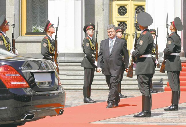 Ukrainian President Petro Poroshenko leaves parliament following the inauguration ceremony in Kyiv Saturday.