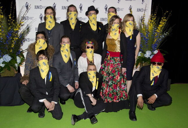 Members of the Lemon Bucket Orkestra wear bandanas in support of Ukraine as they arrive on the green carpet for the Juno Gala.