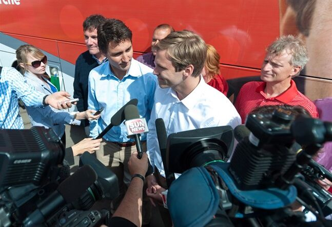 Federal Liberal Leader Justin Trudeau, centre left, and New Brunswick Liberal Leader Brian Gallant speak with the media in Moncton, N.B. on Saturday, August 23, 2014. THE CANADIAN PRESS/Marc Grandmaison
