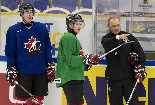 Team Canada head coach Brent Sutter (right) talks with forwards Sam Reinhart (green) and Frederik Gauthier (blue) during team practice at the IIHF World Junior Hockey Championships in Malmo, Sweden on Wednesday December 25, 2013. THE CANADIAN PRESS/ Frank Gunn