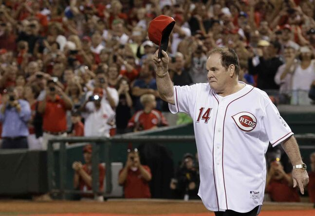 Former Cincinnati Reds great Pete Rose walks onto the field during ceremonies honoring the starting eight of the 1975-76 World Series-champion Reds, following a baseball game between the Reds and the Los Angeles Dodgers in September 2013 in Cincinnati.