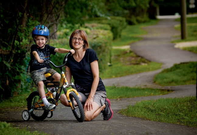 Janet Fritsch and grandson Landon are enjoying Headingley's new walking path.
