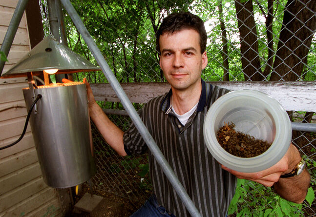 Ken Nawolsky shows off a collection of mosquitoes from a trap in Assiniboine Park in July 2000.