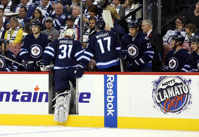 Winnipeg Jets goalie Ondrej Pavelec heads to the bench after being replaced during the second period.