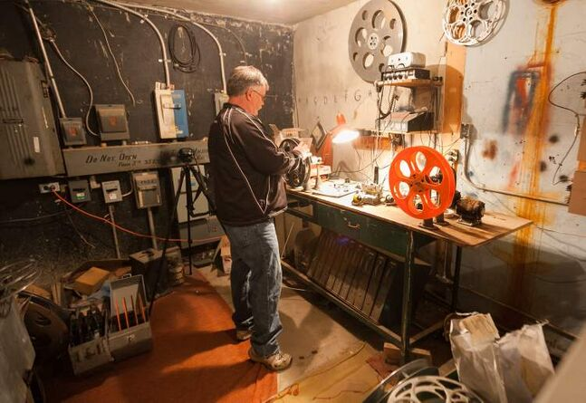 Terry Nelson splices together the previews for the projector prior to showtime at the Stardust Drive-In in Morden.