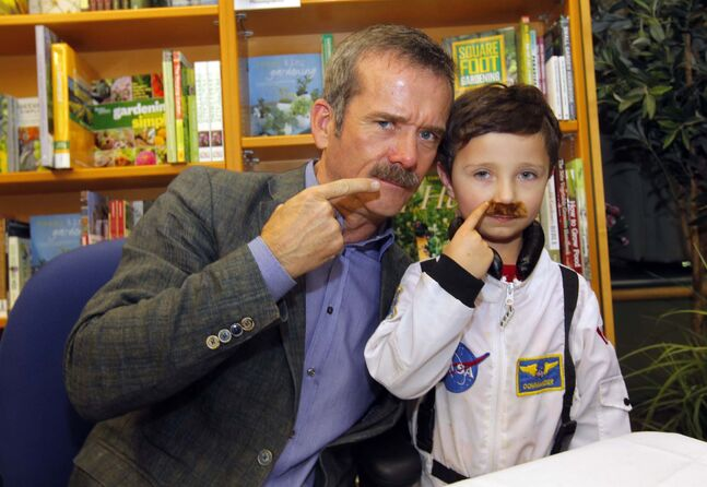 Chris Hadfield poses for a photo with Kahy Thompson at Hadfield's book signing (An Astronaut's Guide to Life on Earth) at McNally Robinson Booksellers last month.