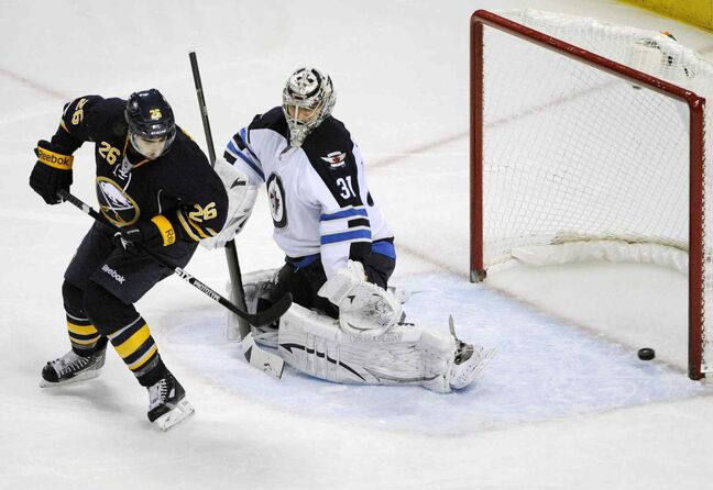 Sabres winger Matt Moulson tips the puck past Jets goalie Ondrej Pavelec, Tuesday in Buffalo.