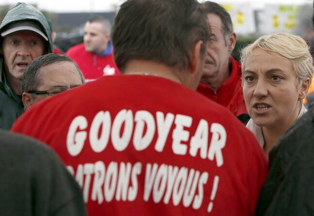 Goodyear workers listen to politicians during a gathering against layoffs in Amiens, Nov. 7, 2013 . THE CANADIAN PRESS/AP, Francois Mori