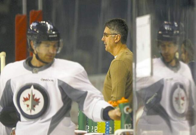Jets head coach Claude Noel makes a brief appearance at team's optional practice on Wednesday at the MTS Centre while Jim Slater heads for a breather.