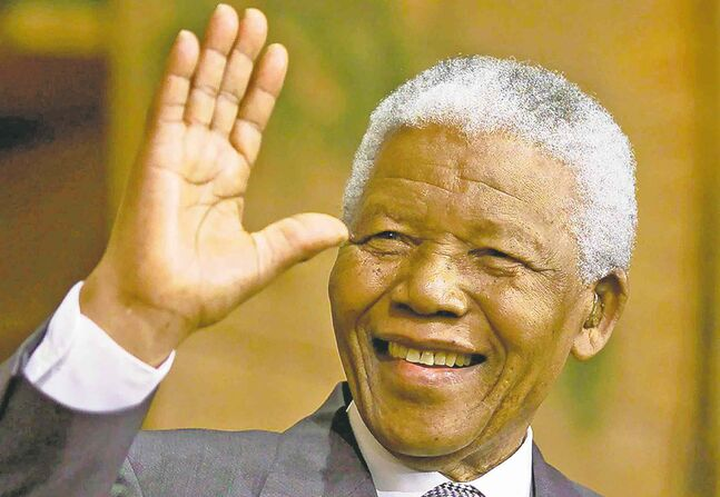 Nelson Mandela, prisoner and president, fought white rule in South Africa and became an international hero.