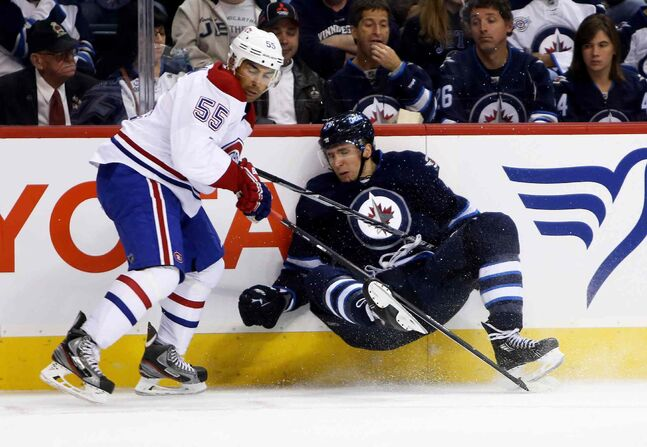 Montreal Canadiens' Francis Bouillon checks Winnipeg Jets' Blake Wheeler during second-period NHL action at the MTS Centre in Winnipeg Tuesday.