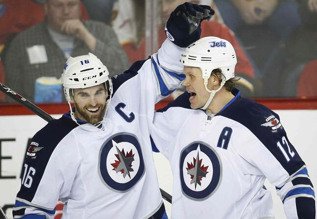 Winnipeg Jets' Olli Jokinen, right, celebrates his second-period goal with teammate Andrew Ladd Thursday.