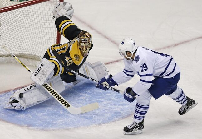 Boston Bruins goalie Tuukka Rask makes a sliding pad save on a shot by Toronto Maple Leafs winger Joffrey Lupul during the first period.