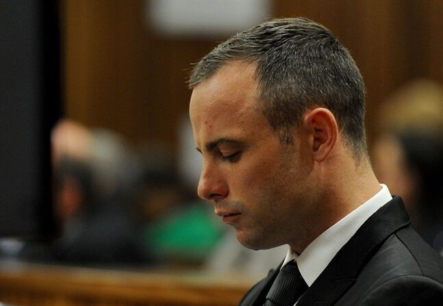 Oscar Pistorius in court for his ongoing murder trial in Pretoria, South Africa, Monday, May 12, 2014. Pistorius is charged with the shooting death of his girlfriend Reeva Steenkamp on Valentine's Day in 2013. (AP Photo/Chris Collingridge, Pool)